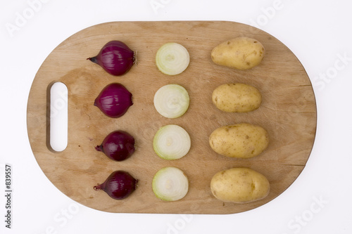 onion and potatoes on wooden board