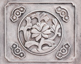 flower engraved on stone poster