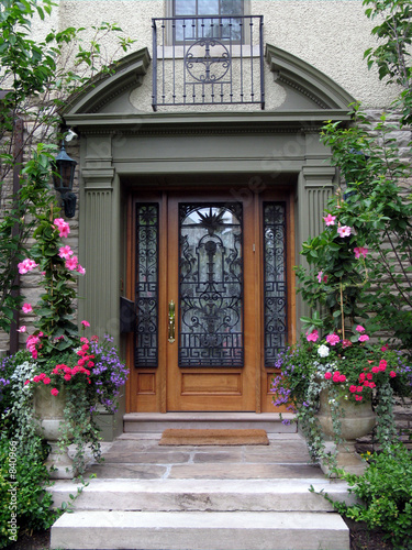 beautiful front door with flowers by Sam Spiro, Royalty free stock