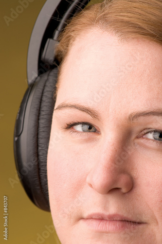 poster of women with headphone