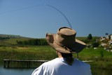 lady angler casting a fly line poster