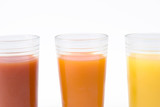 glass of orange tomato and kiwi juice - close up poster