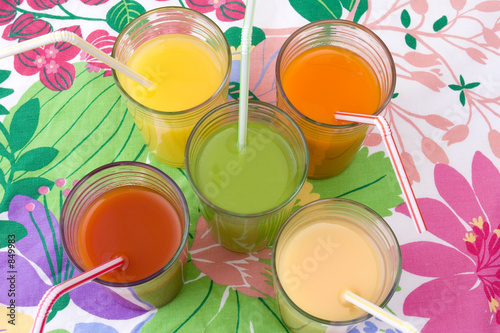 poster of five glasses of various juices with straws