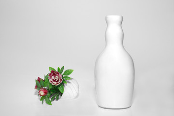 white vase and flowers