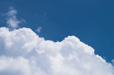 white clouds with blue sky above at midday - image 19 poster