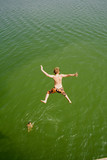 kid jumping into water poster