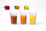 orange, tomato and kiwi juices - in glasses with s poster
