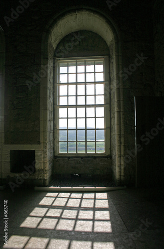 sunshine through arched windows in stirling castle