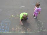 children drawing on asphalt family house poster