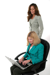 two business women working on laptop 13
