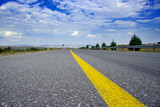 empty highway road with a yellow streak poster