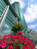 exhibition centre building with flowers poster