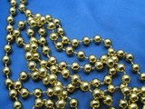 golden beads on blue background poster