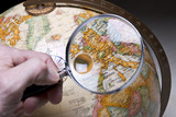 globe and magnifying glass poster