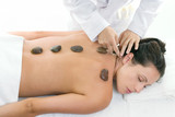 female receiving a relaxing massage treatment poster