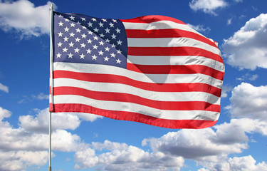 bright beautiful clouds with american flag