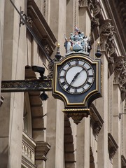 big ornate clock in the city of london