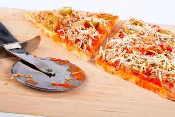 detail of slices italian pizza and cutter