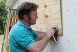 attaching plywood to windows poster