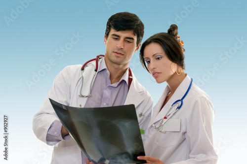 poster of two doctors conferring over x-ray results