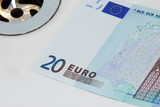 euro banknote going down the drain poster
