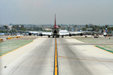 heavy plane on taxiway poster