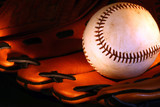ball and glove bathed in soft light poster