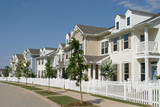 row of suburban townhouses poster