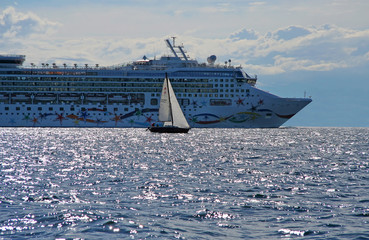 cruise liner and a small yacht