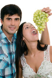couple playfully eating grapes poster