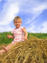 girl on hayrack