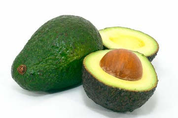 green avocado with cut ripe