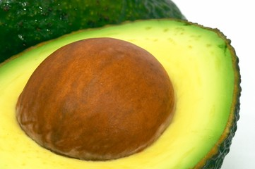 cut avocado and whole closeup