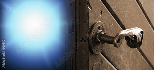 poster of antique door - close-up. ray of light coming from backside.