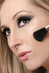 woman's face and makeup brush