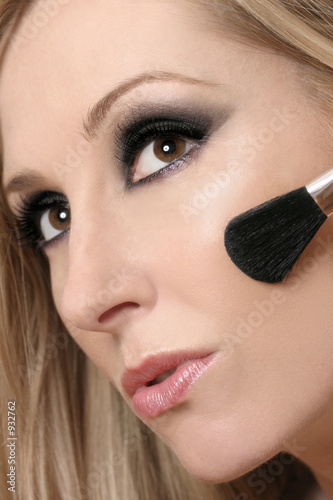 woman's face and makeup brush