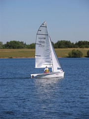 sailing dinghy in full sail
