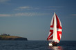 yacht on sunrise near island