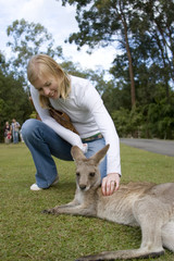 woman petting kangaroo at australia zoo