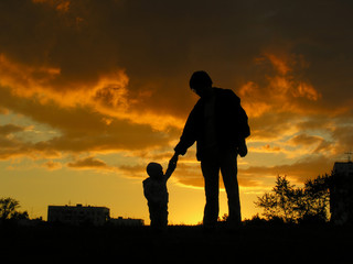 father with baby sunset