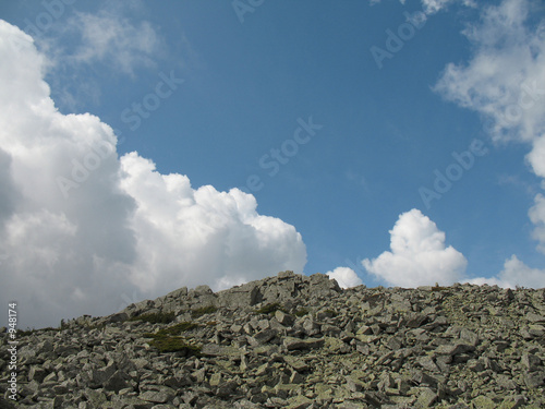 landscape with stones, sky and clouds