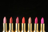 several lipsticks for make up poster