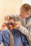 eye doctor performing eye examination poster