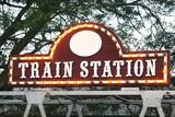 amusement park train station sign poster