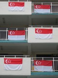 singapore flag hang on apartment blocks poster