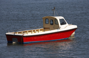 small wooden motor boat