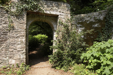 doorway through to a lush green garden