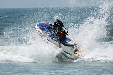 lifeguard on jetski in surf