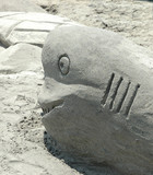 sand sculpture of a dolphin poster