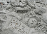 sand sculpture of pirate and skulls poster